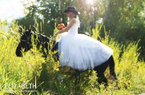 bride horseback riding at a ranch