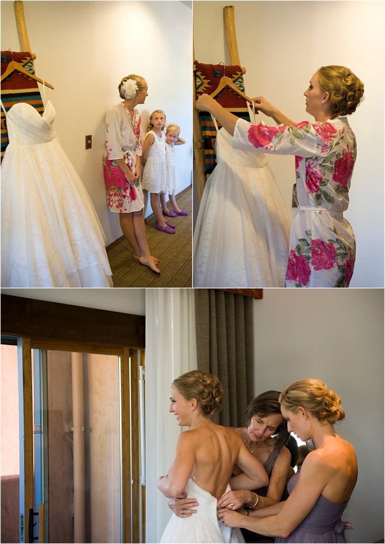 bride getting ready, putting on the dress, bridesmaids, floral robes,wedding day, clear creek history park, golden, colorado wedding planner, mountain wedding photographer, hotel room, table mountain inn