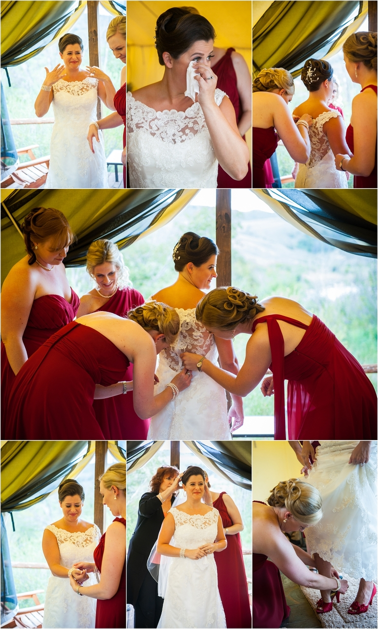 bride getting ready, red bridesmaids gowns, putting on wedding dress,C Lazy U Ranch, Granby, Colorado, Rustic Ranch Wedding, Colorado Wedding Planner, Mountain Wedding Photographer